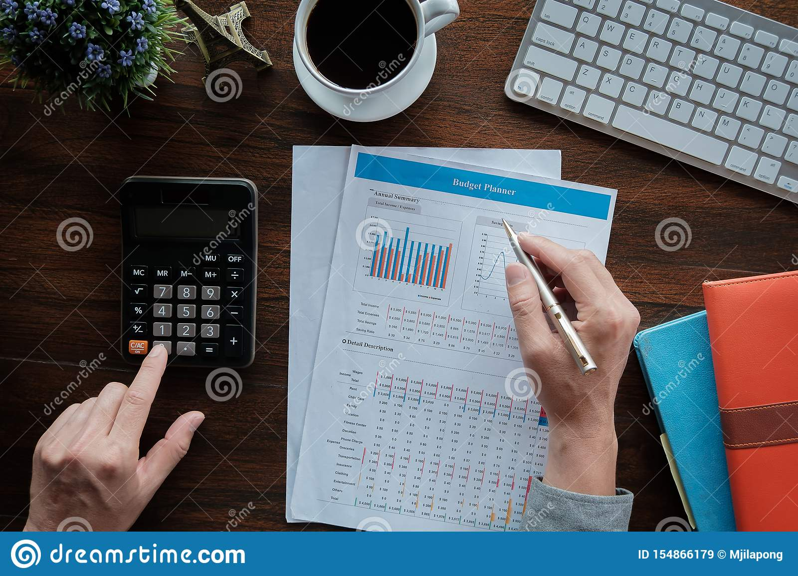 Business accounting concept, Business man using pen pointing with data budget planner chart and calculator for calculate