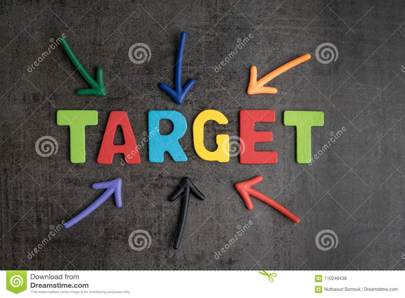 business aiming target plan for success concept multi colorful magnet arrows pointing at wooden letters the word target at the center on chalkboard loft