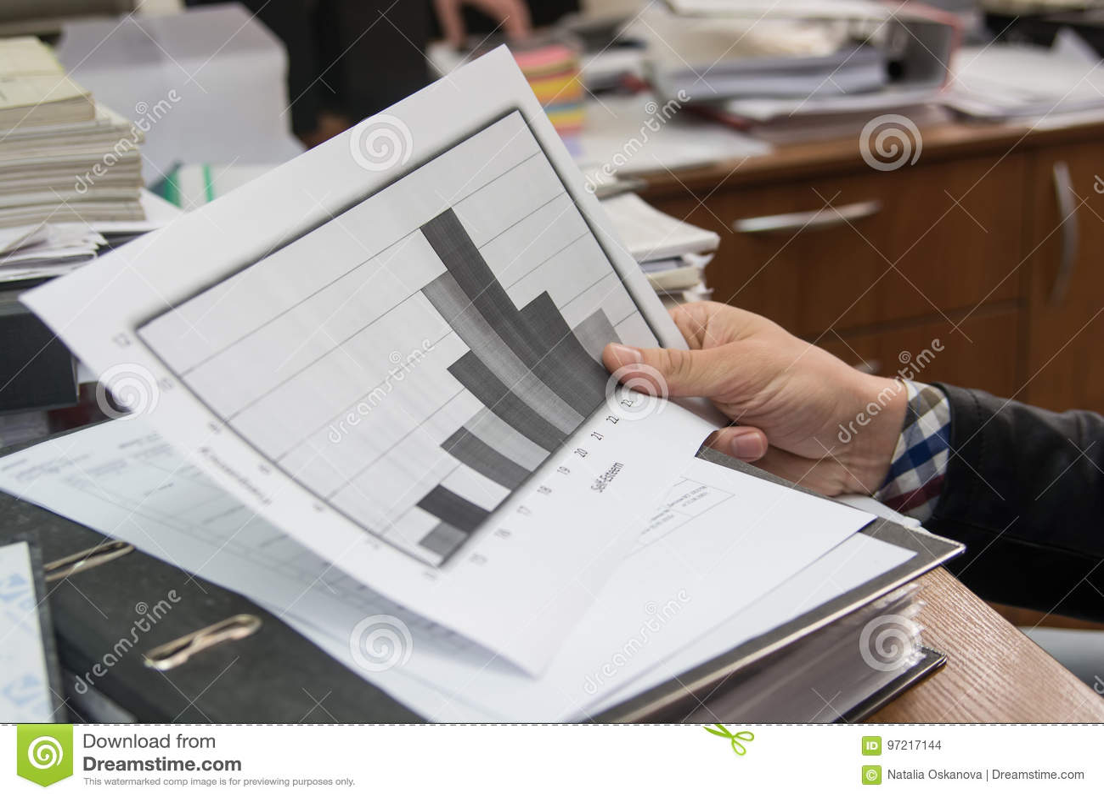 Business analyst examining diagram