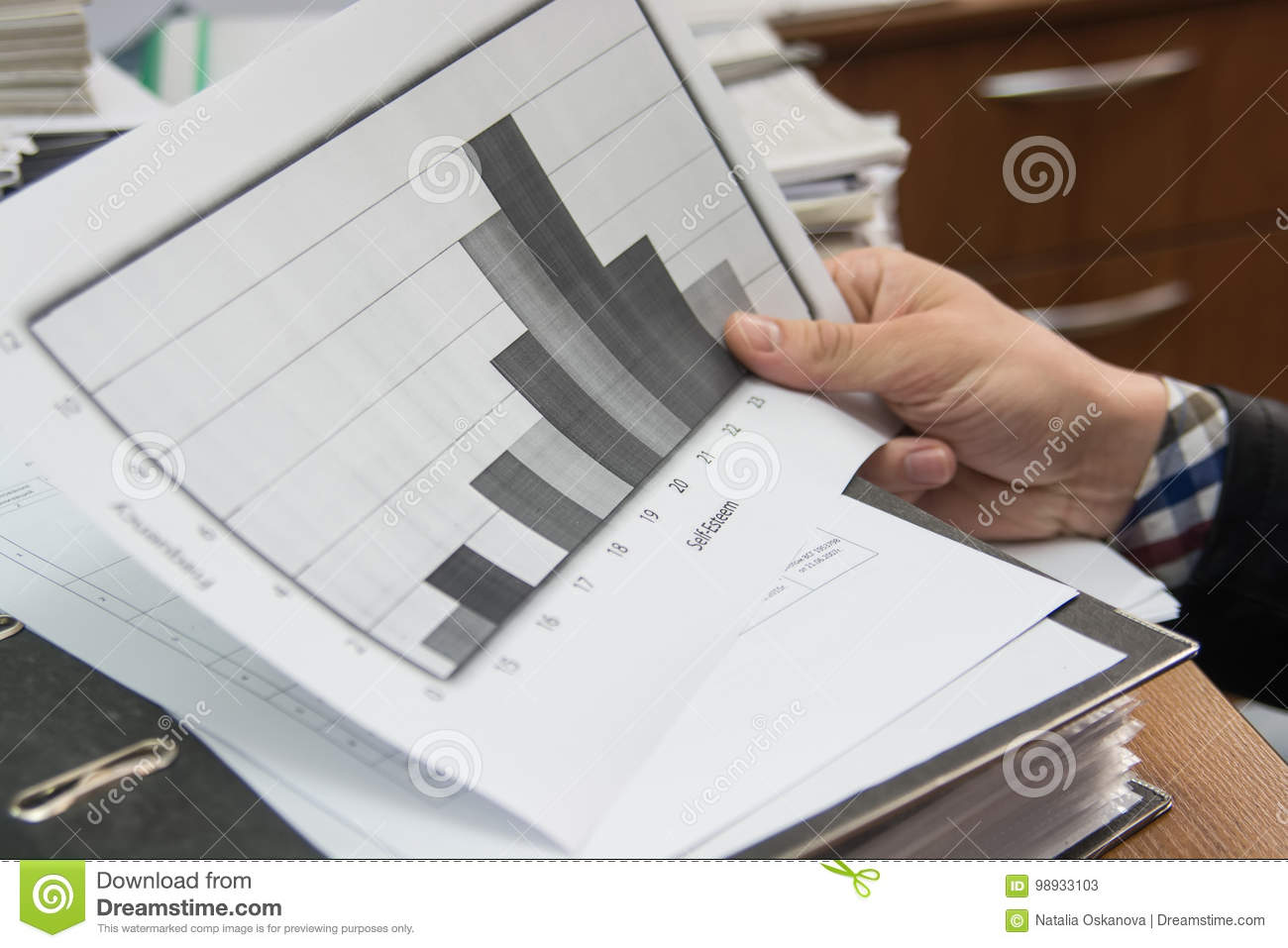 Business analyst examining diagram