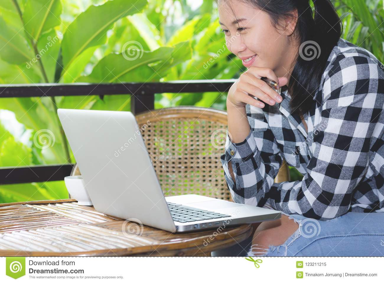 Business Asian woman working with laptop and looking in monitor