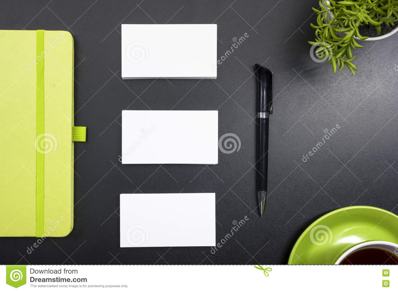 Business card blank, notepad, coffee cup and pen, flower at office desk table top view. Corporate stationery branding