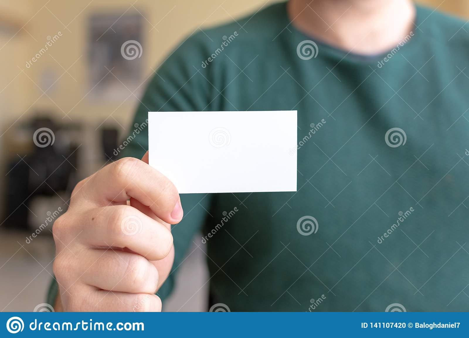 Business Card Mock-Up - Man Holding a Blank Card for Clients. Business Card Template