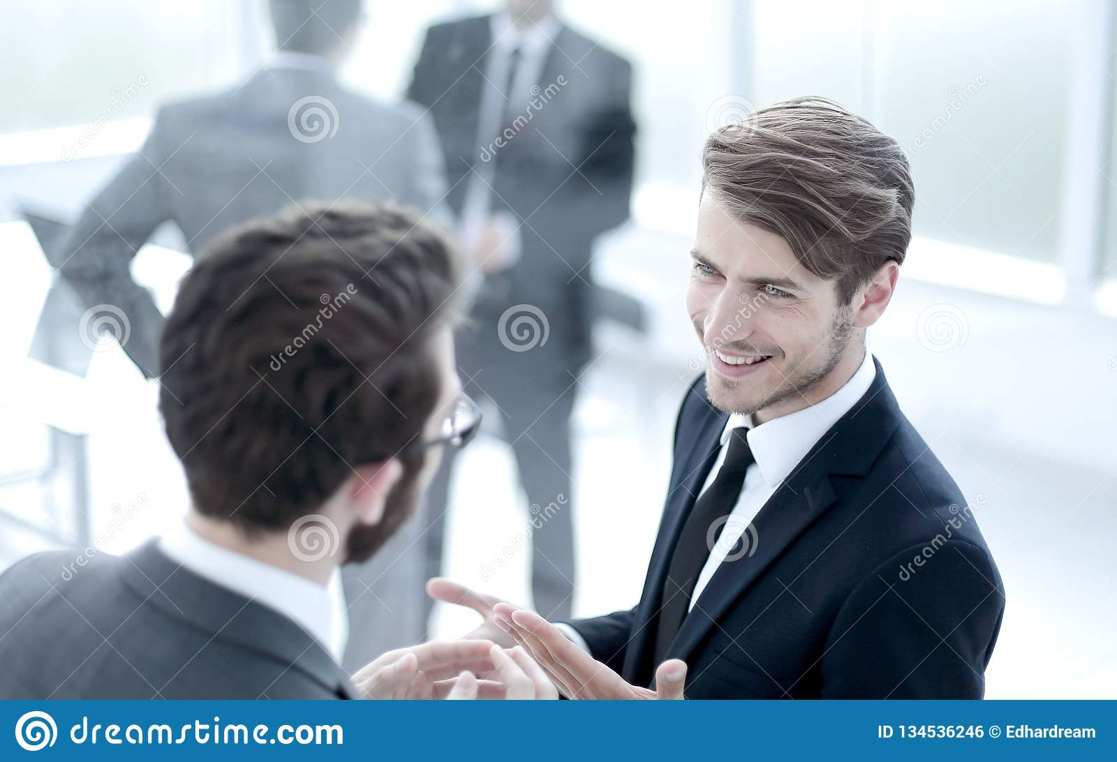 Business colleagues talking standing in the lobby of the busines. S center.office weekdays royalty free stock image