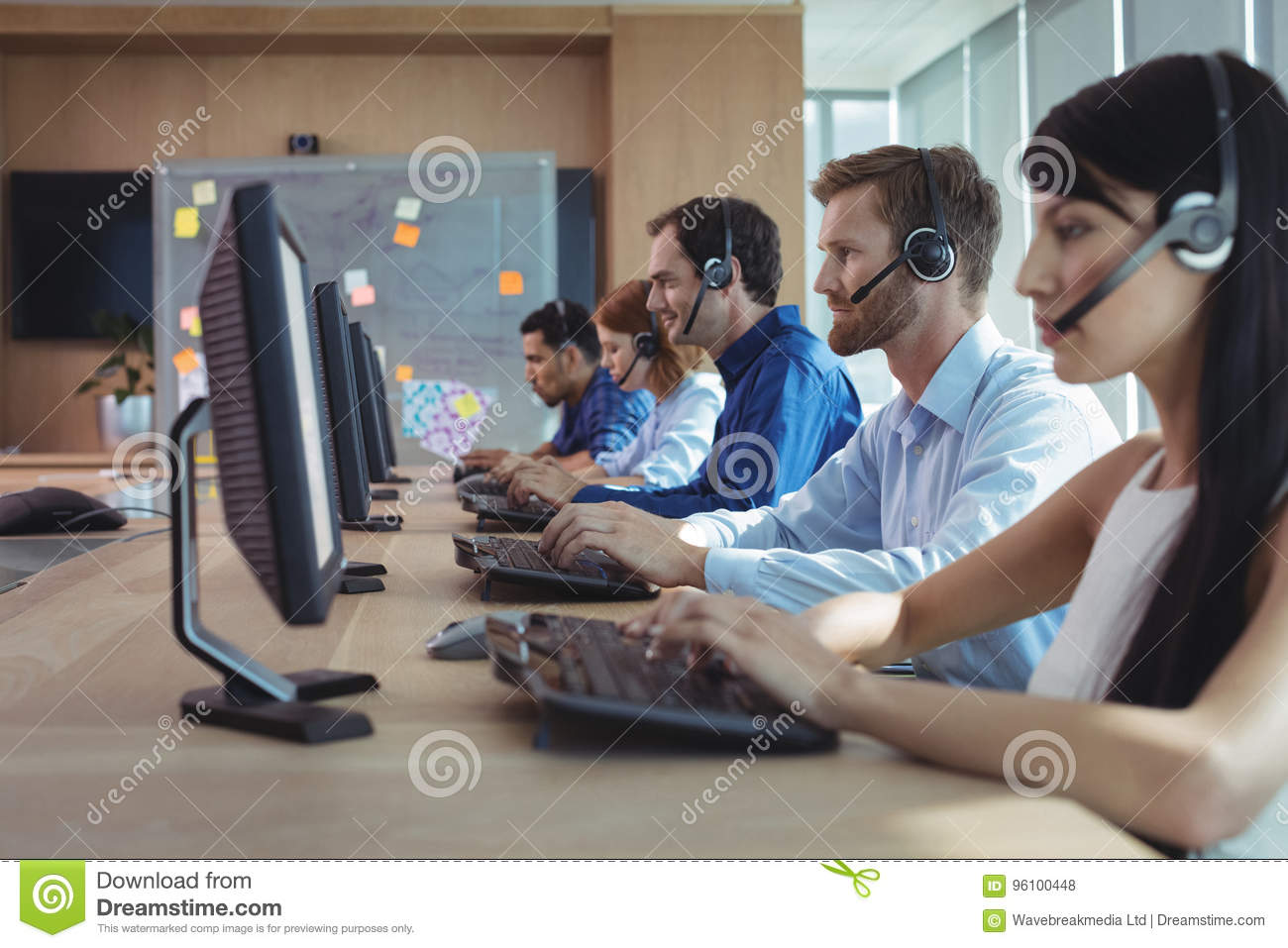 Business colleagues working at call center