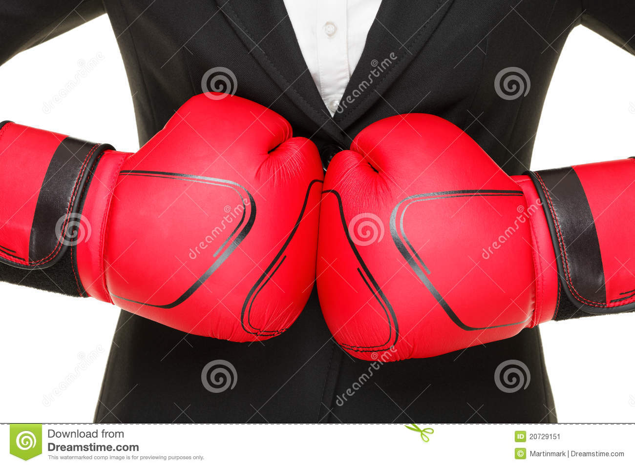 Business concept - boxing gloves and suit