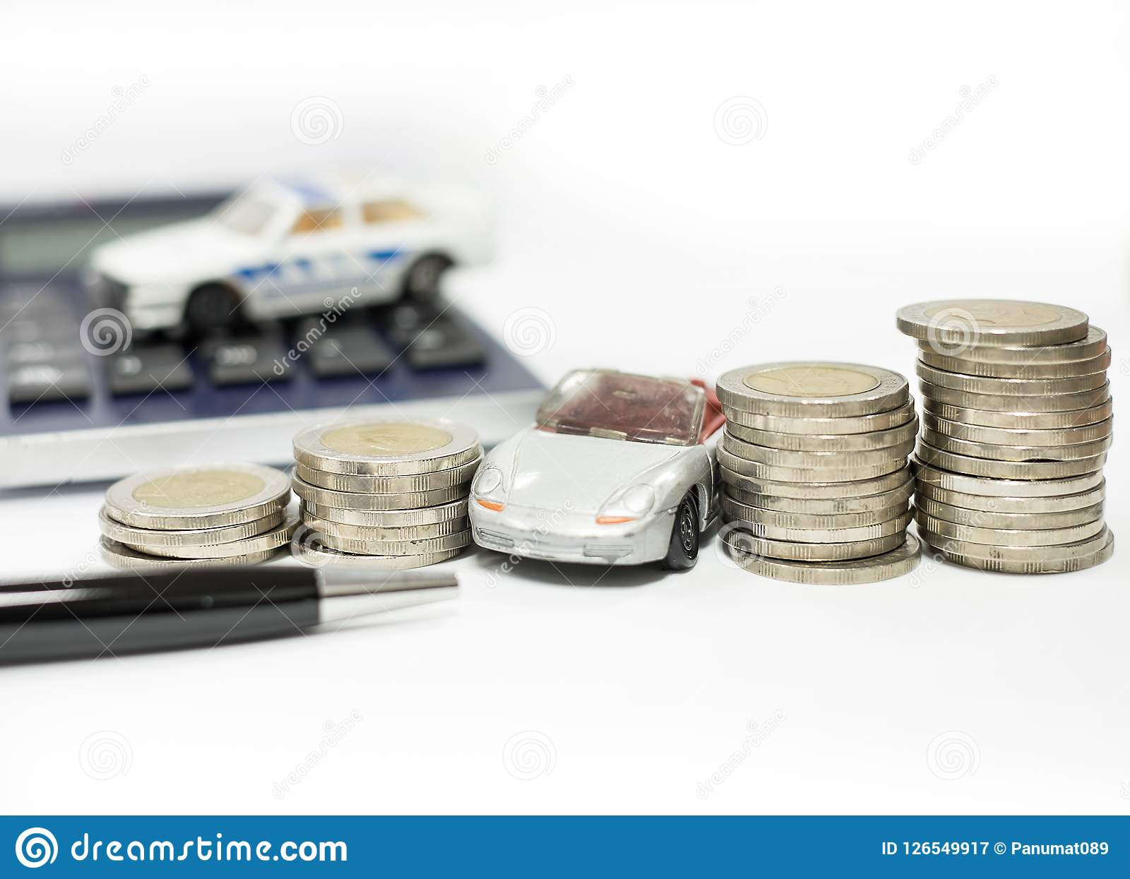 Business concept of car loan, gray car and stacks of coins