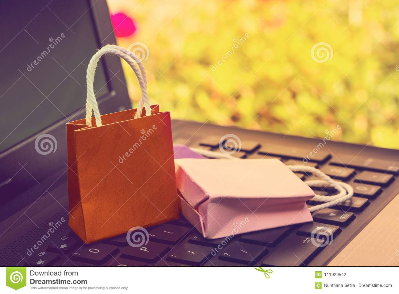 Business concept online shopping, paper shopping bags on notebook keyboard. Online shopping e-commerce or services on