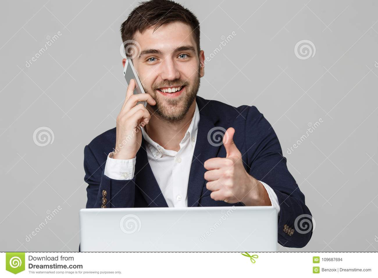 Business Concept - Portrait Handsome Business man showing thump up and smiling confident face in front of his laptop