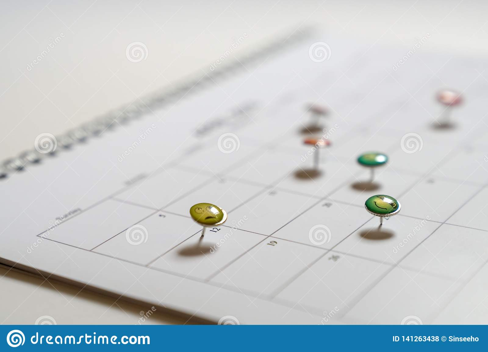 Business concept: thumbtack in calendar as reminders for meetings and appointments