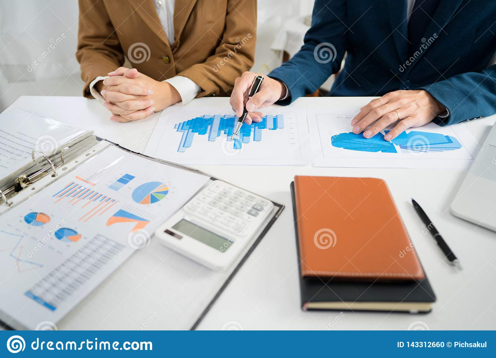 Business Corporate team brainstorming, Planning Strategy having a discussion Analysis investment researching with chart at office