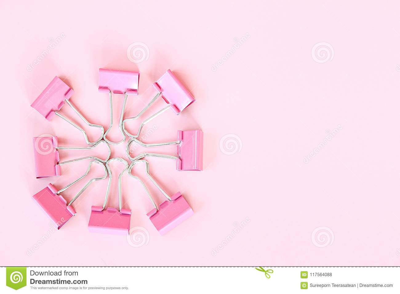 Group Of Pink Binder Clip On Pink Background With Copy Space Stock