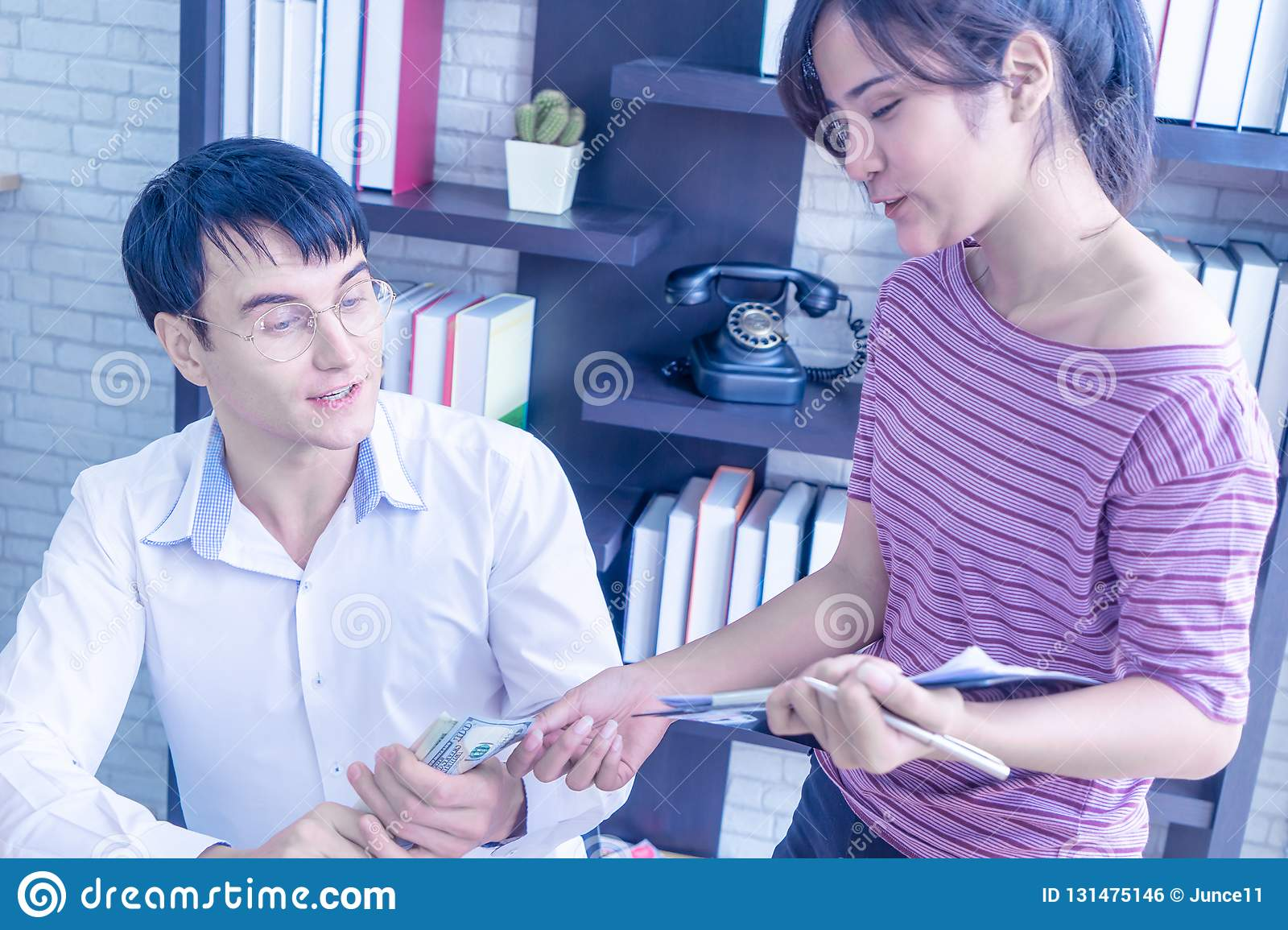 Business couple checking stock in their online home business
