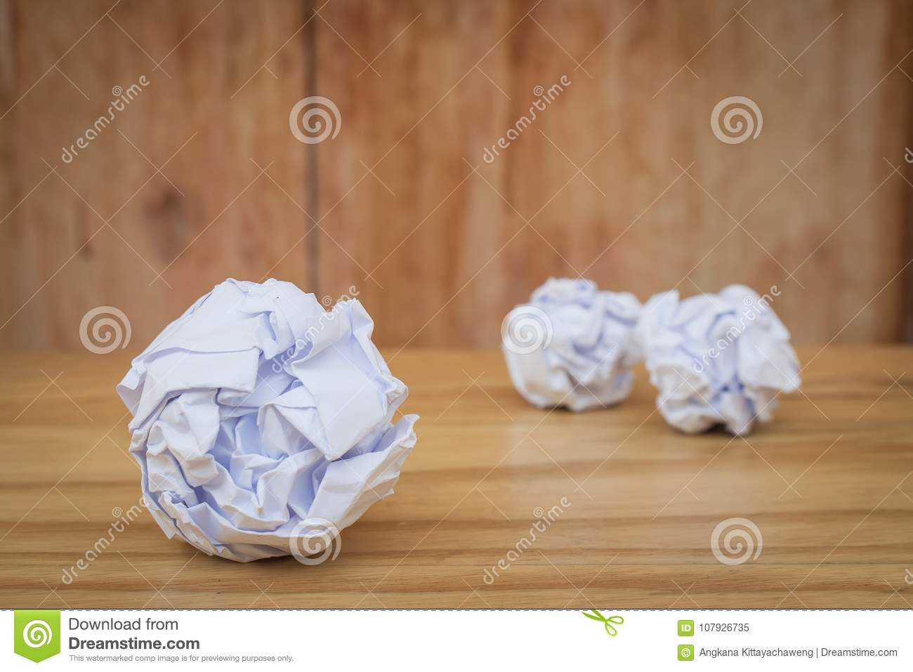 Business Creative and Idea Concept : Close up many white crumpled paper ball put on wooden foor.
