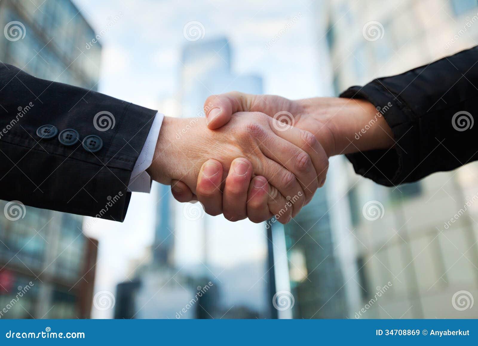 Business people handshake greeting deal at work photo free download - Buildings Business Handshake