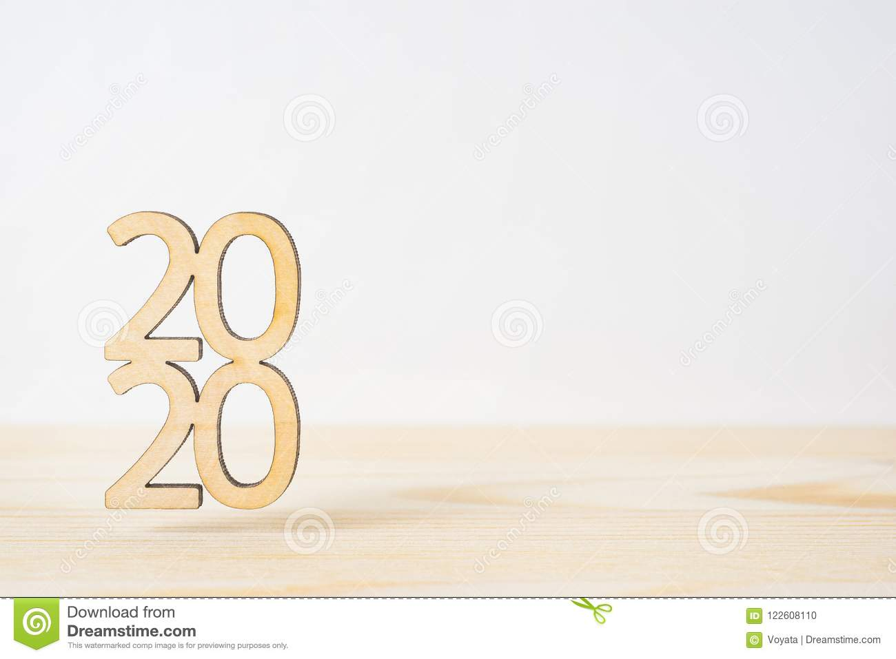 Wooden word 2020 on table and white background