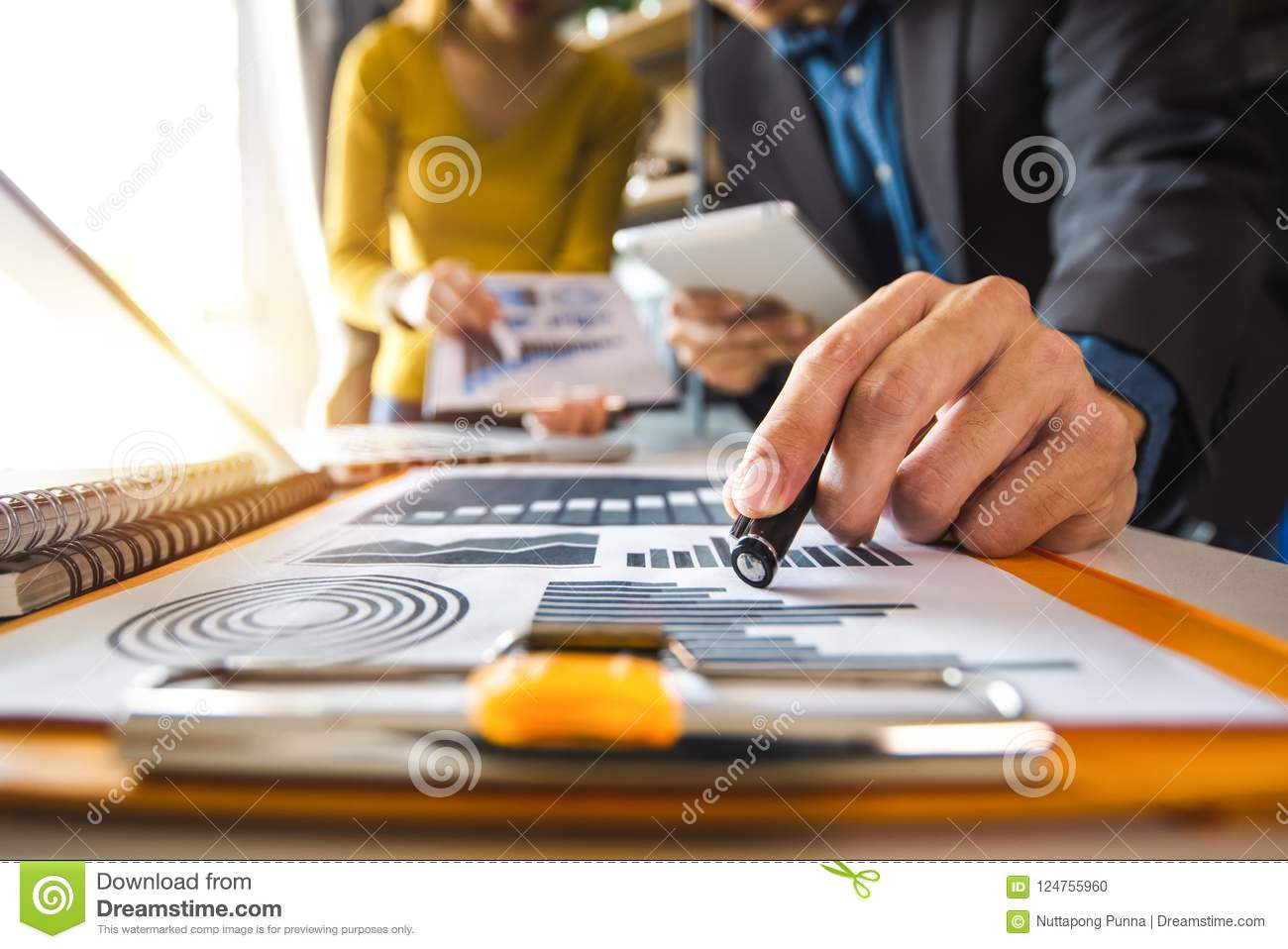 Business documents on office table with smart phone and digital tablet and graph