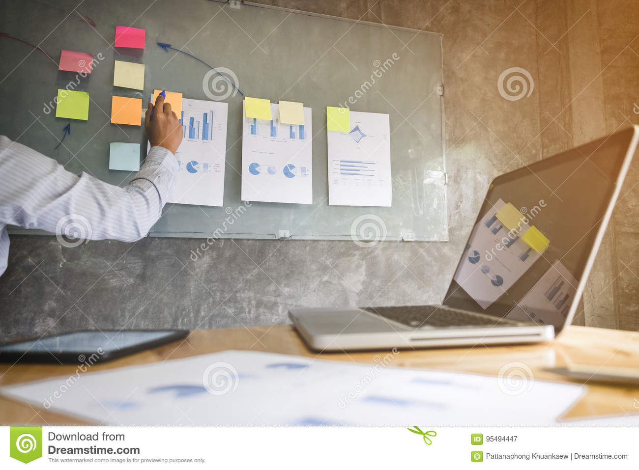 Business executive making presentation to colleagues in office,