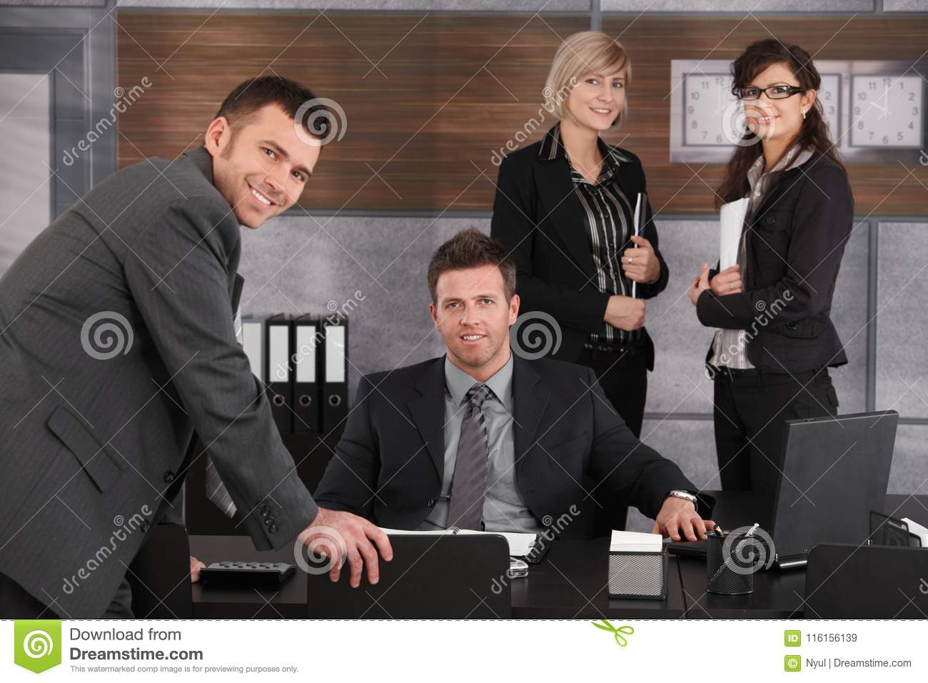 Business executive with team around.