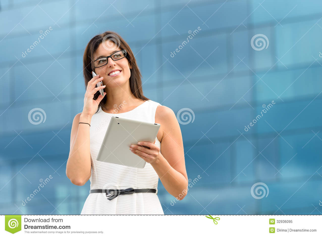 Business executive with tablet and phone