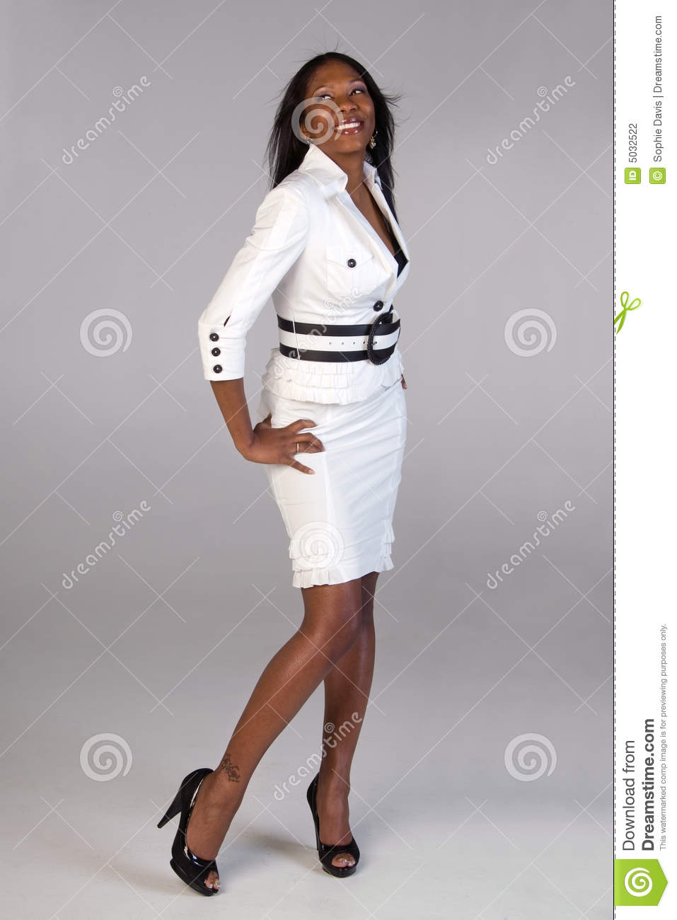 Beautiful African American woman smiling as she models a white