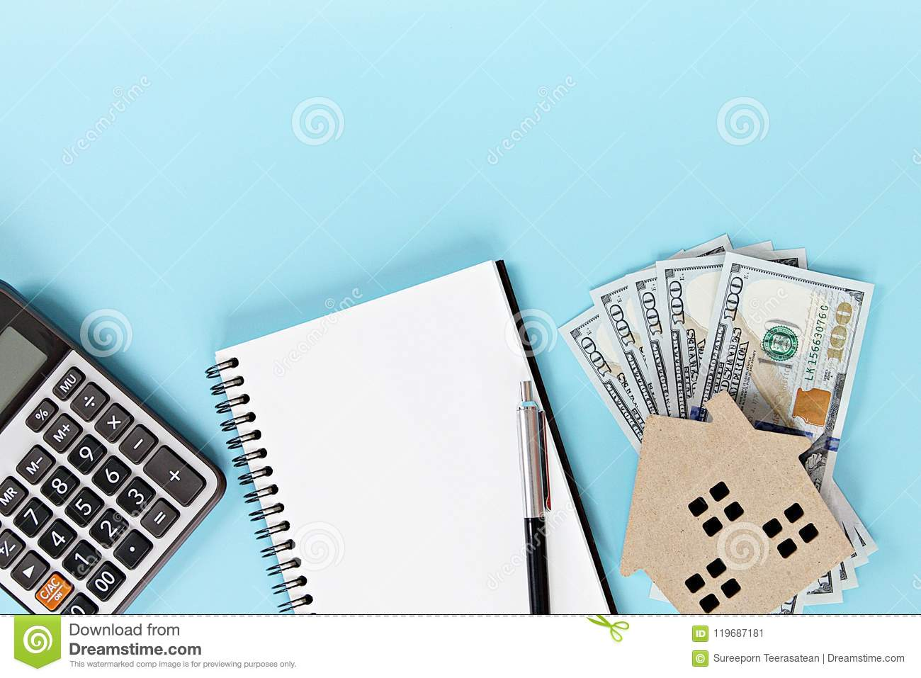 house model american dollar cash money notebook and calculator on
