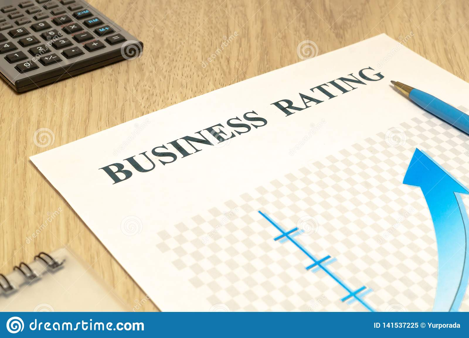 Business financial rating chart with pen and calculator