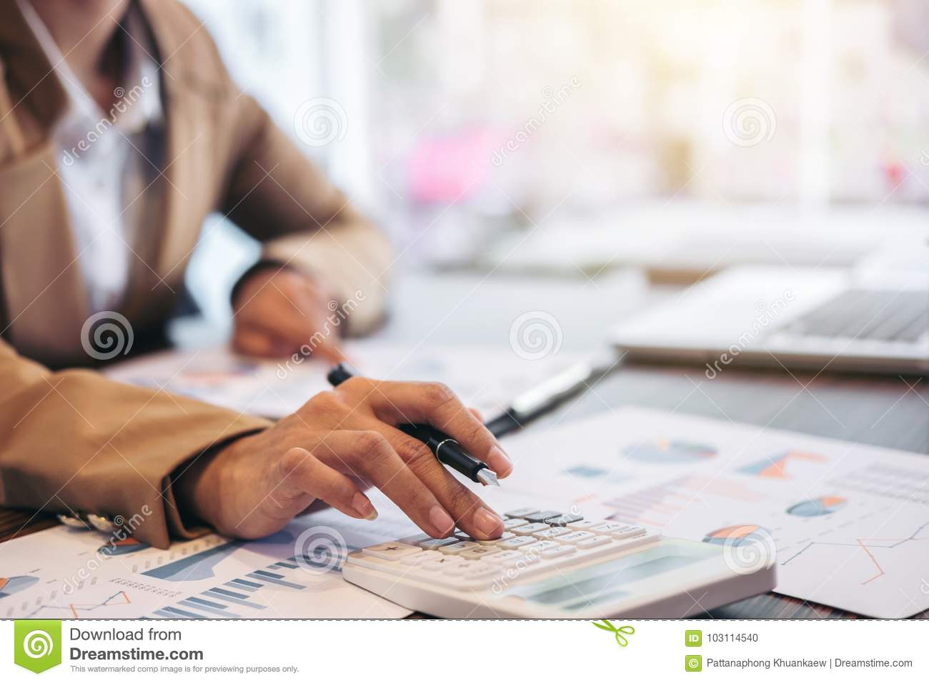Business Financing Accounting Banking Concept, businesswoman doing finances and calculate about cost to real estate investment