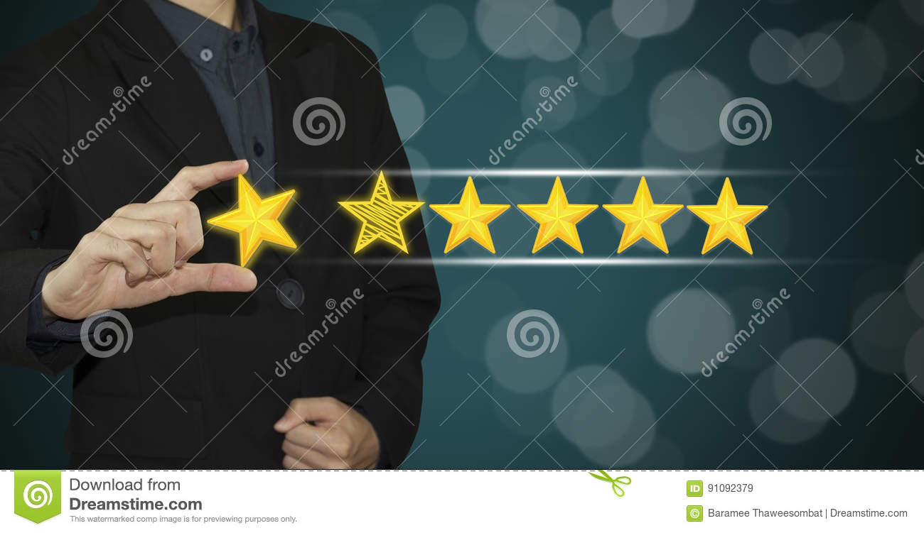 business hand select yellow marker on five star rating  stock image