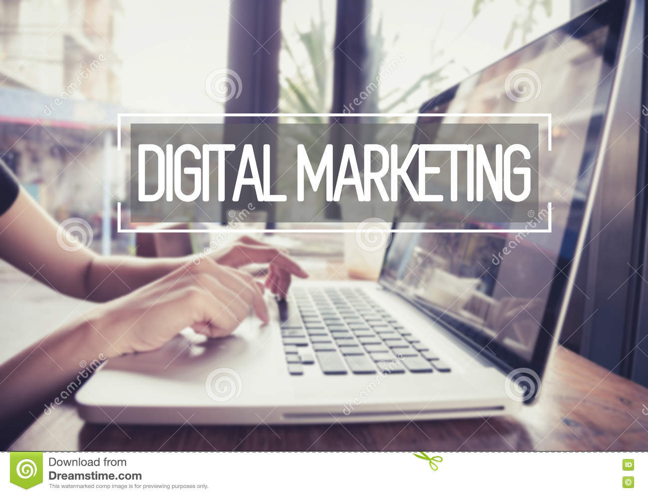 Business hand typing on a laptop keyboard with digital marketing.