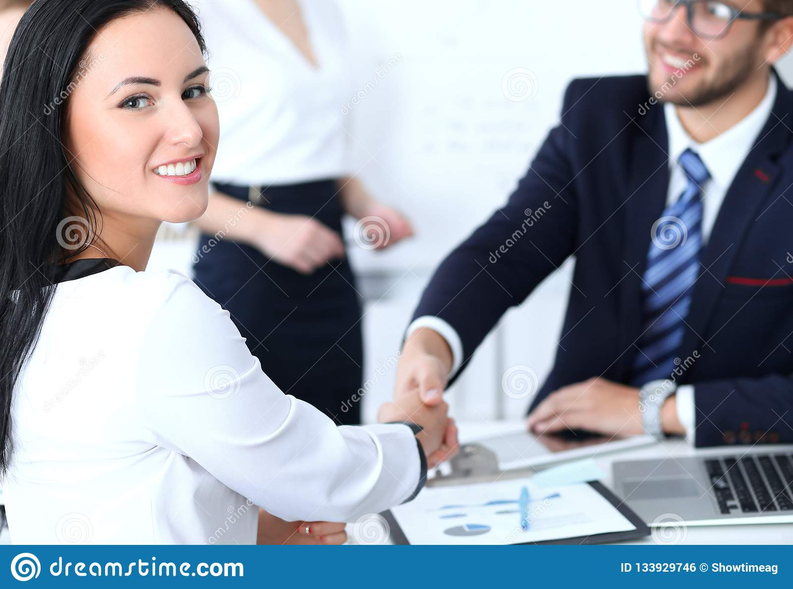 Business handshake at meeting or negotiation in the office. Two businesspeople partners are satisfied because signing