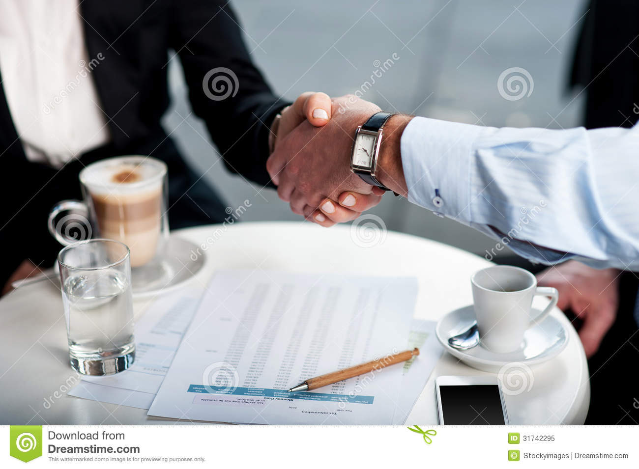 Business handshake over a coffee royalty free stock photo for Coffee business