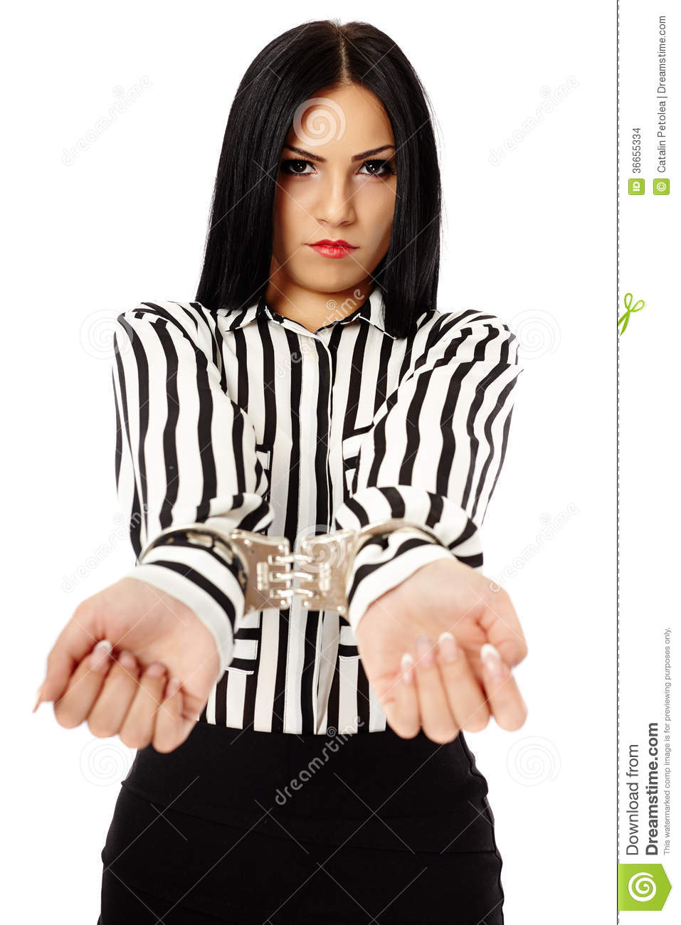 Young businesswoman with handcuffs isolated on white background.