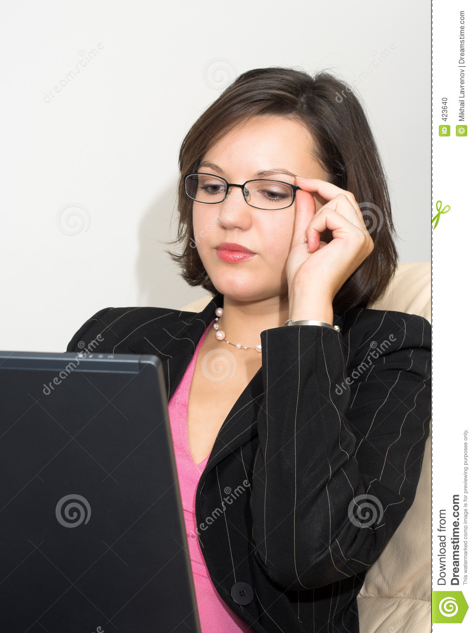 Business lady with a laptop touching her glasses