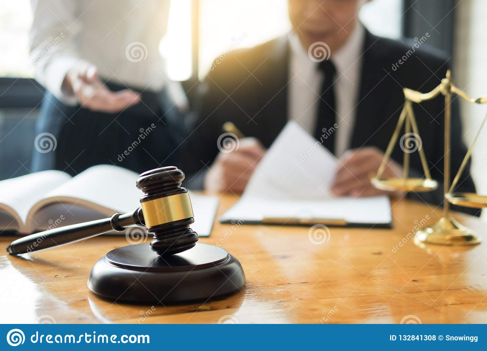 Business lawyer judge working about legal legislation Consultation with insurance with gavel and balance for deciding on