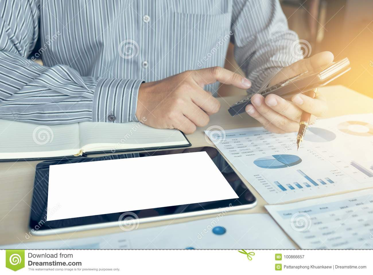 Business man or accountant working Financial investment on calculator with calculate Analyze business and market growth on