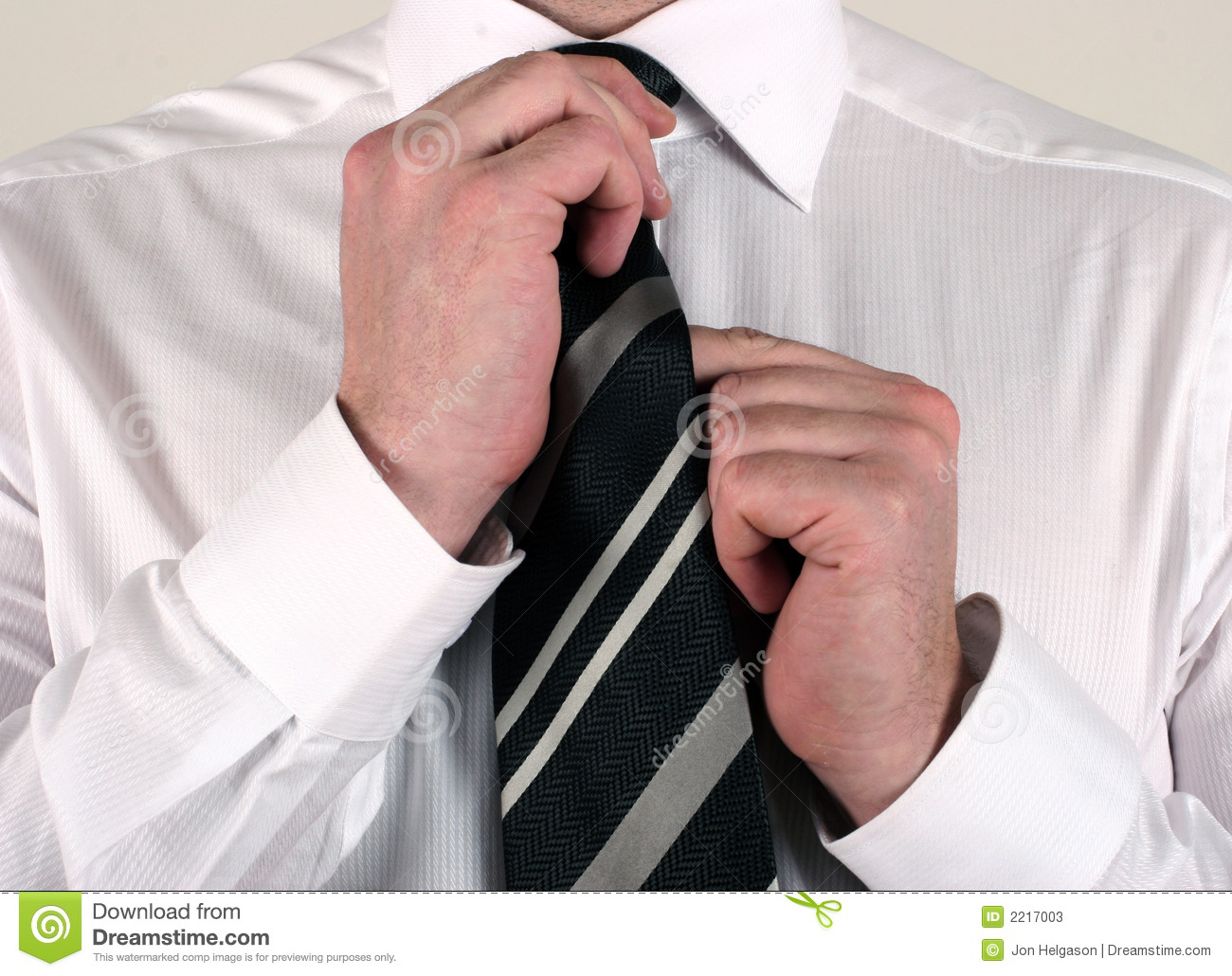 business-man-adjusting-tie-2217003.jpg