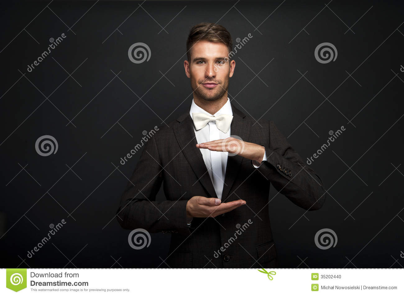 Technology Management Image: Business Man With Cupped Hands As If Holding Something