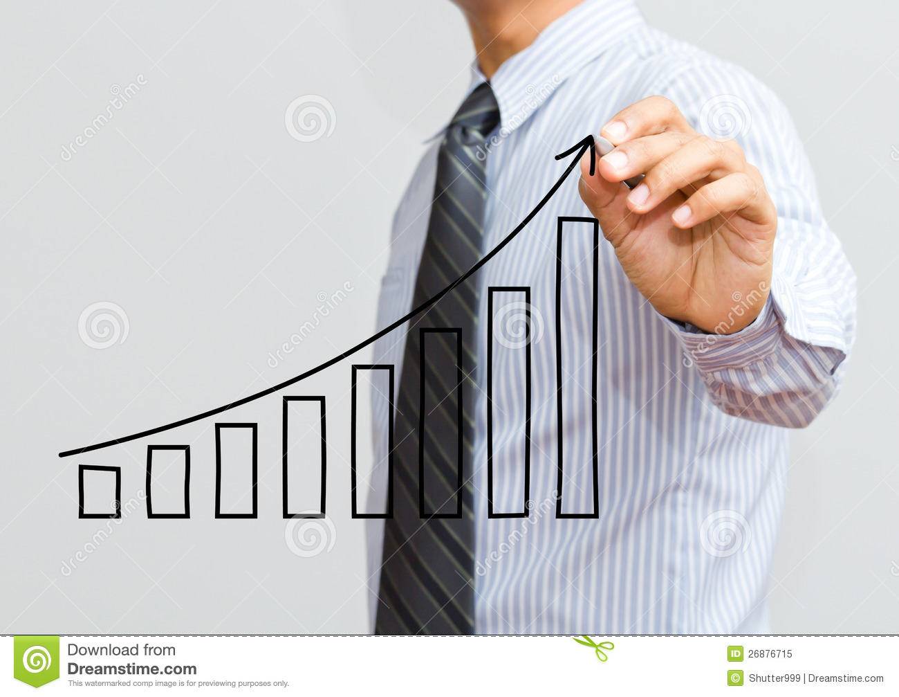 business-man-drawing-growing-graph-26876715.jpg