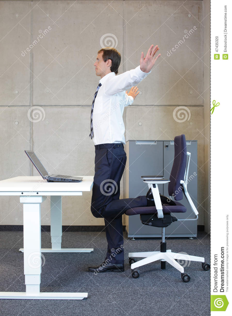 business man exercises in office - Office Chair For Short Person