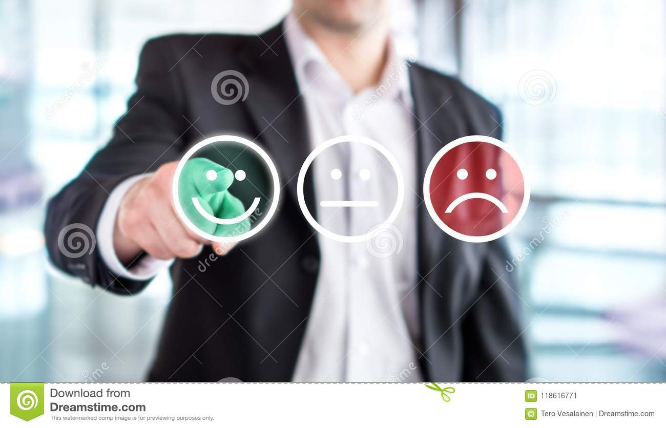 Business man giving rating and review with happy smiley face.