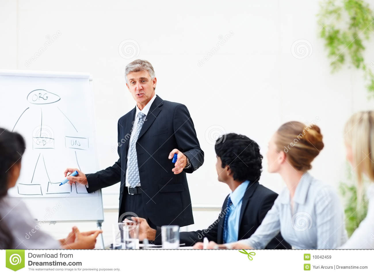 Business man giving training to his colleagues