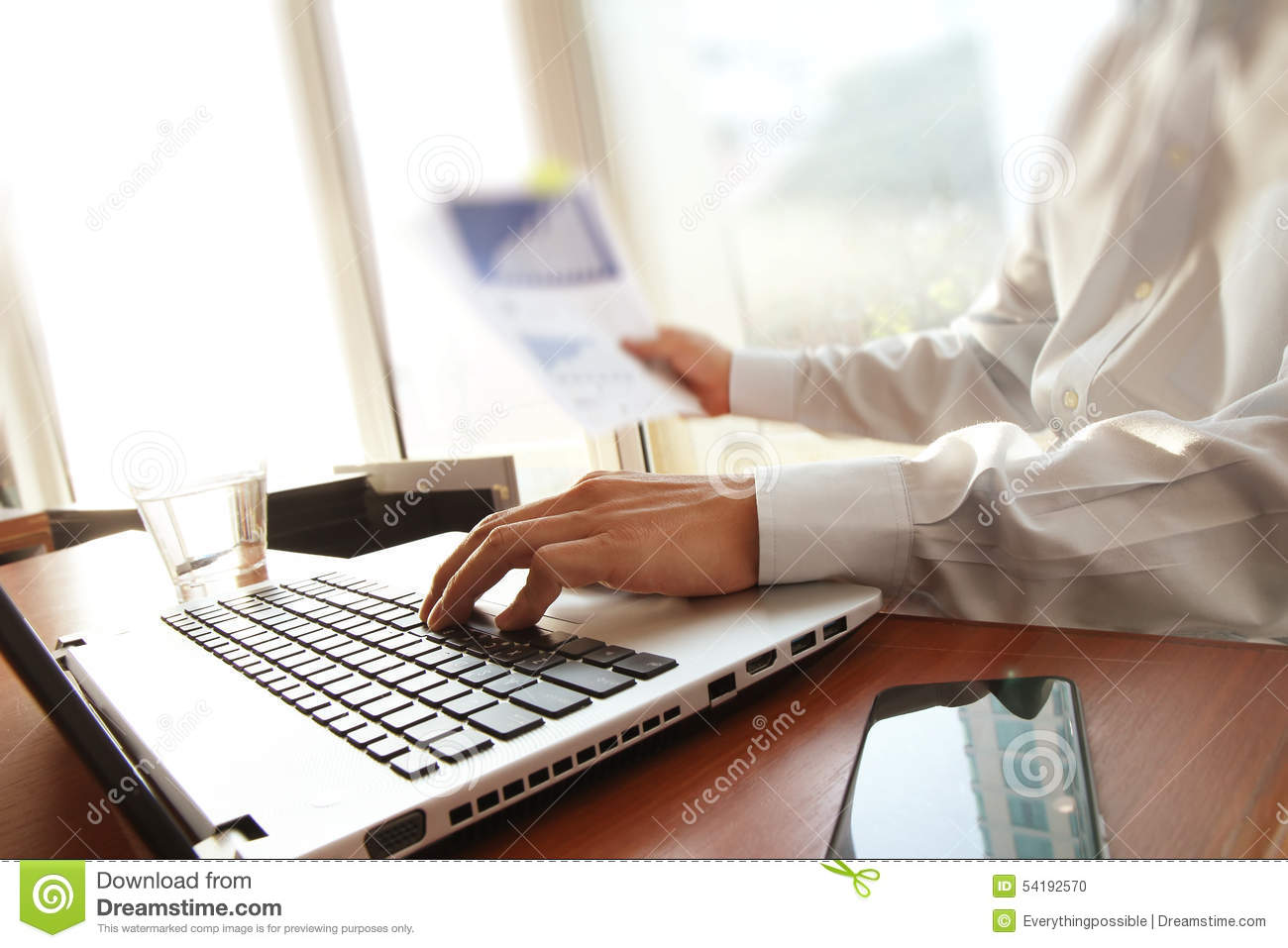 Business man hand working on laptop computer