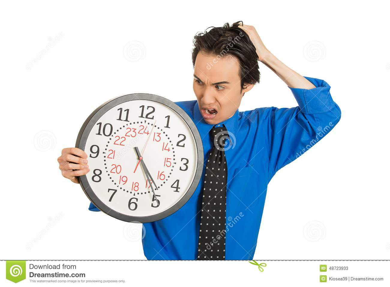 Business man holding clock stressed, pressured by lack of time