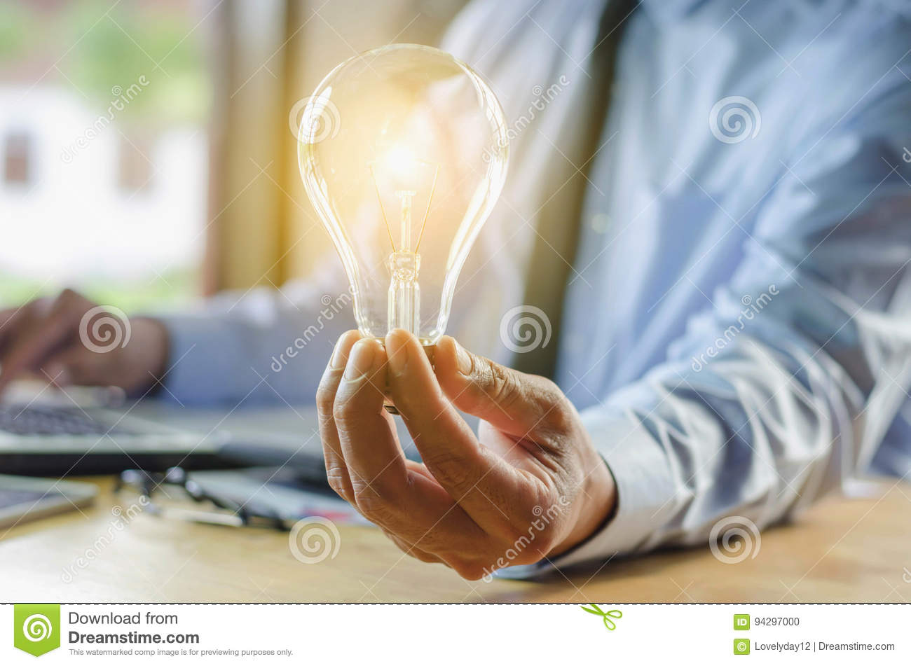 business man holding light bulb, concept idea with innovation