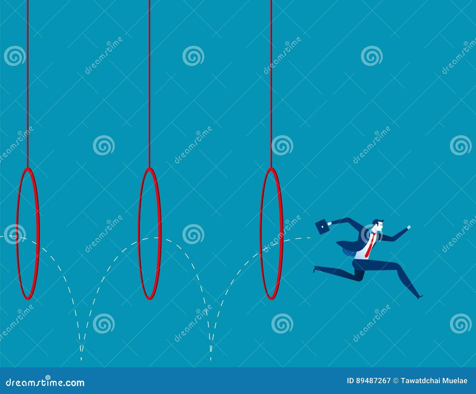Business man jumping through hoops