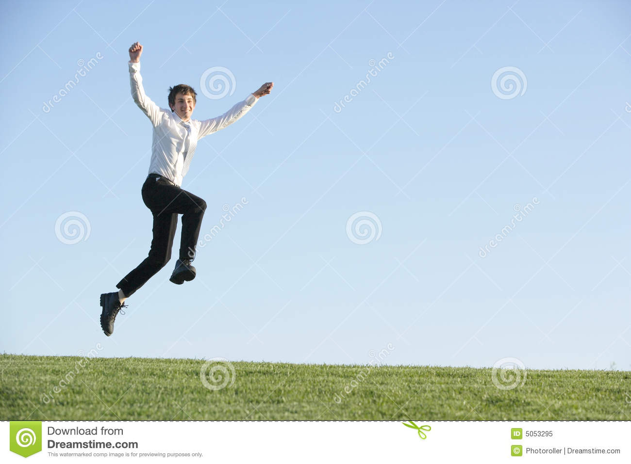 a business man jumping for joy royalty free stock photo