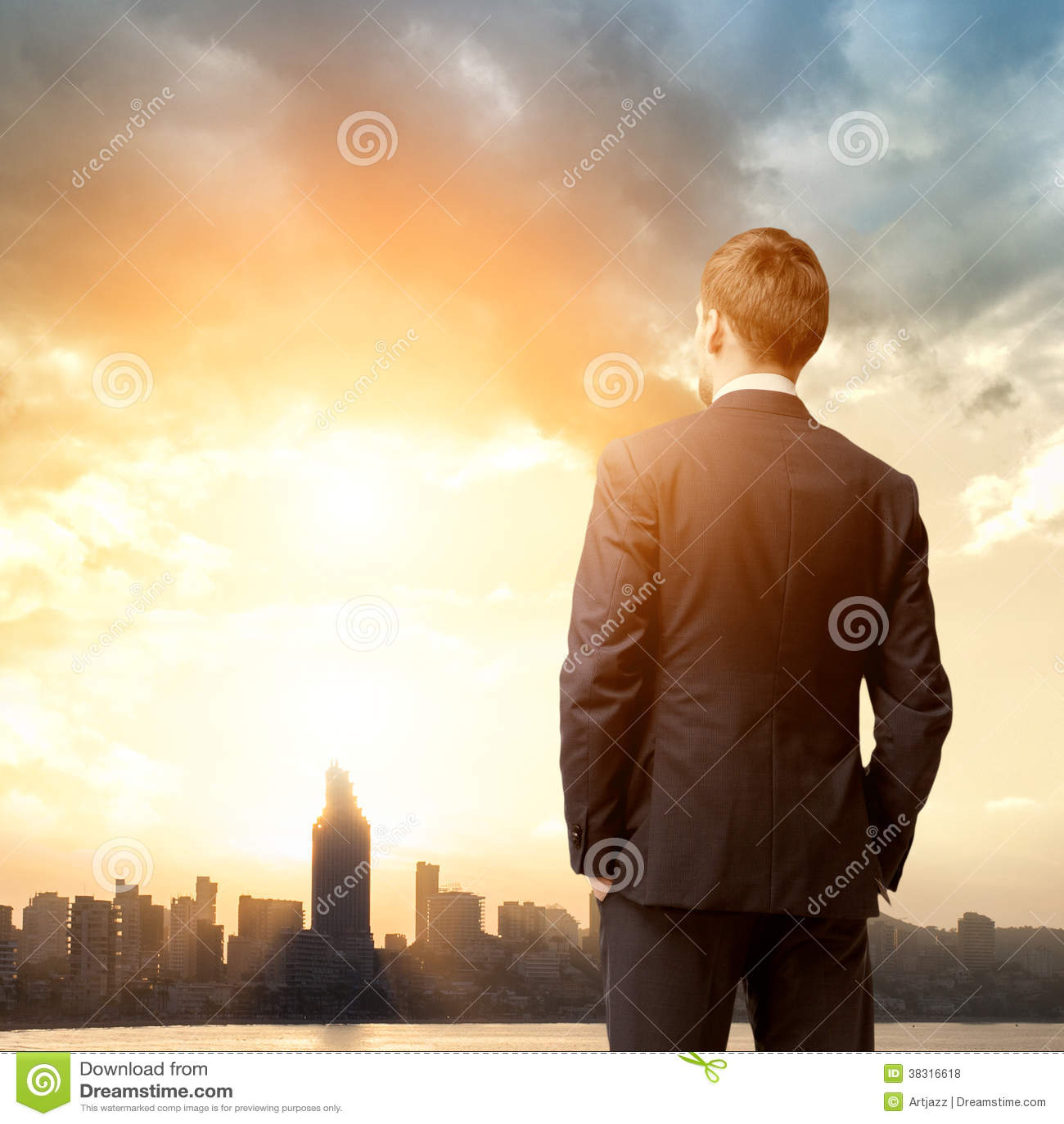 Business man look sunrise