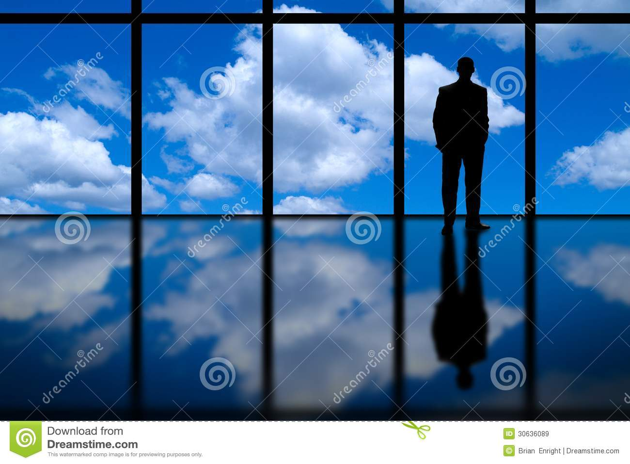 Business Man Looking Out of High Rise Office Window at Blue Sky and Clouds