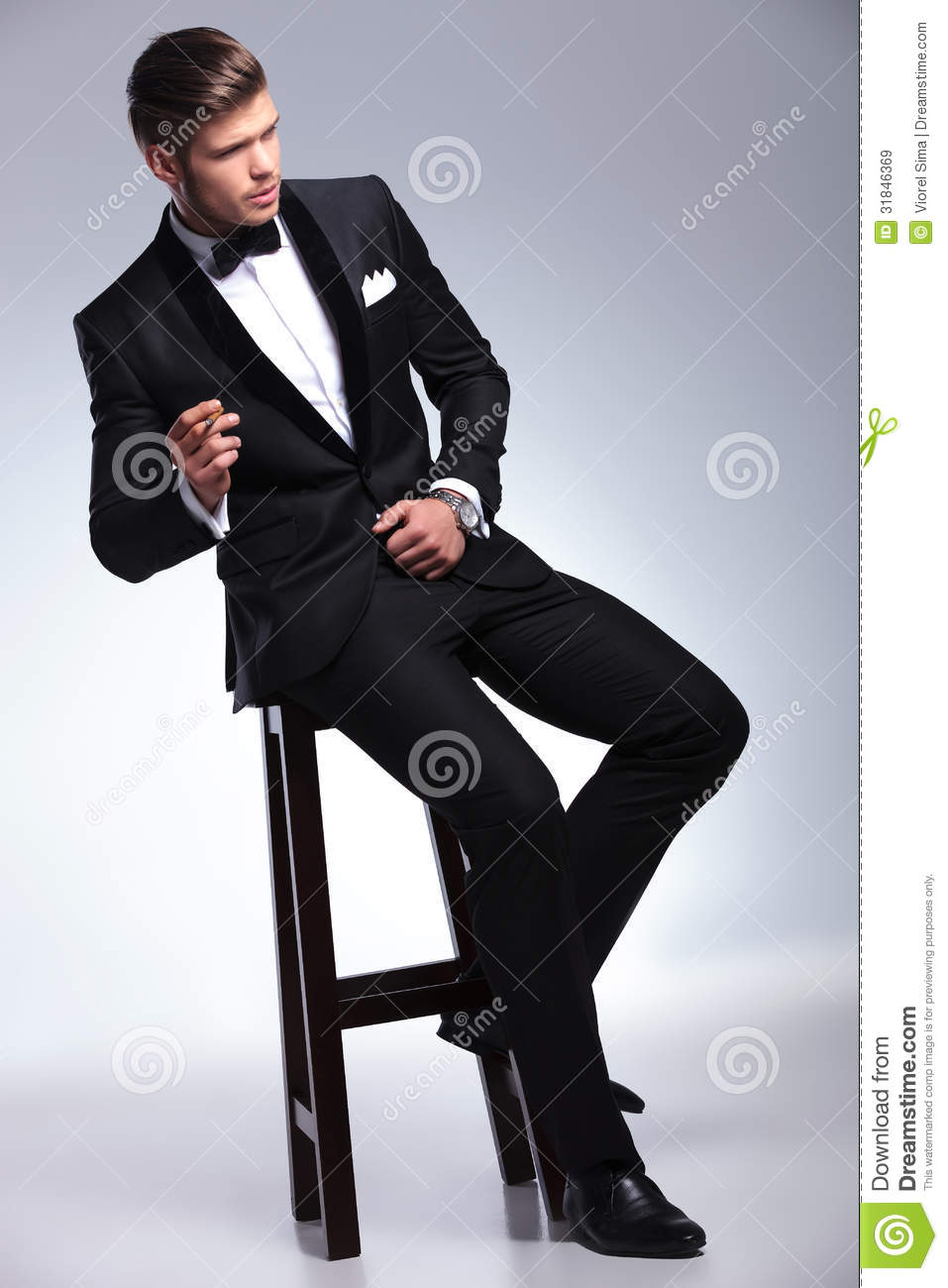 Business Man Looks Away While Smoking On Chair Royalty